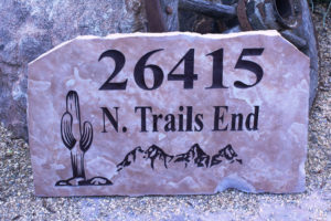 flagstone sign with street address