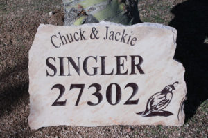 flagstone sign with address